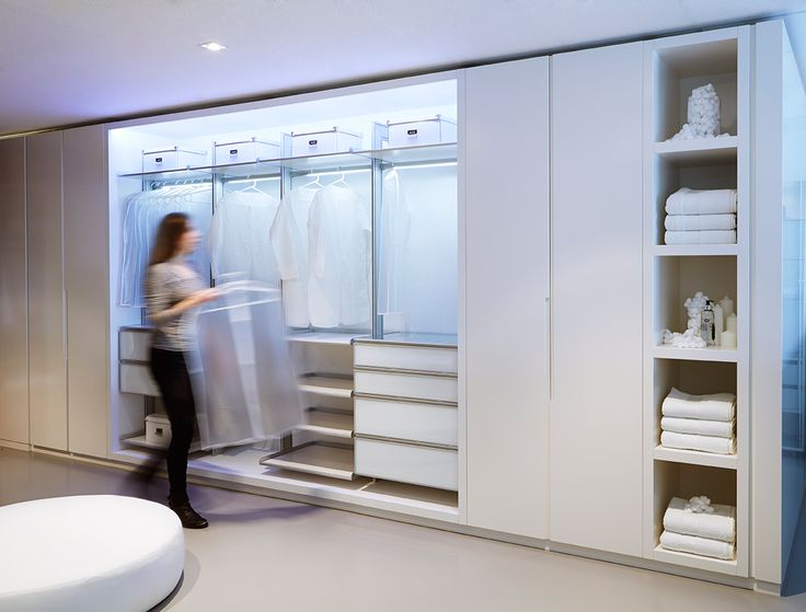 A wardrobe design combining the XIMULA wardrobe system from Singapore, with white satin polyurethane cabinetry designed and manufactured in Australia by GELOSA .