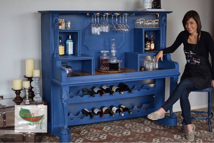 A Antique upright grand piano turned into a bar and then painted with Annie Sloan Napoleonic blue chalk paint®, a wash of Paris Grey was added to the details. This piece was done by CindyB.