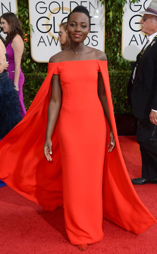 Lupita Nyong'o is perfection at the Golden Globes in this caped Ralph Lauren creation! #fashion