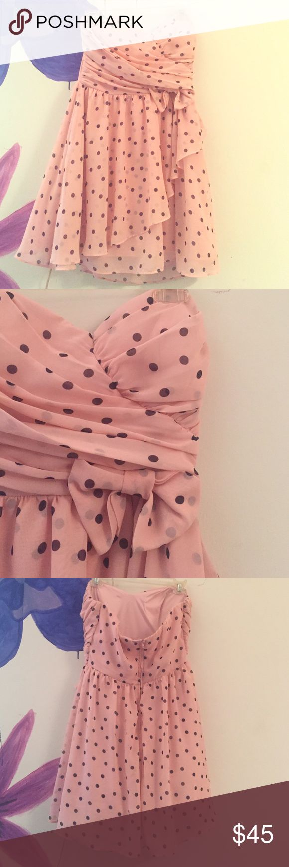 Polka dot semi-formal dress It's a beautiful light pink and navy/plum polka dot dress with lots of layers and tulle underneath, I've only worn it once and I grew out of it, it's in beautiful condition, wish I could still fit in it. B. Smart Dresses Strapless