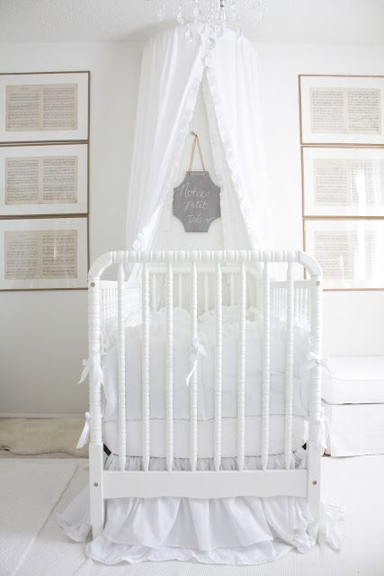 Pretty little nursery! Love the lullaby sheet music in frames!