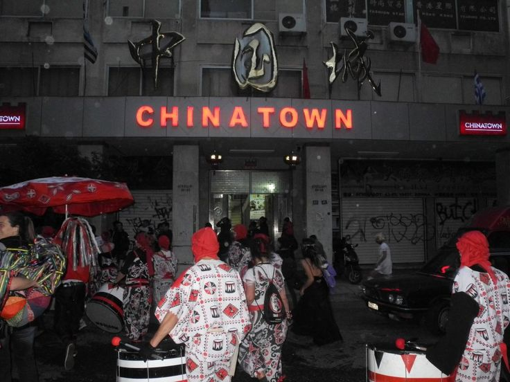 "Revelers heading to the ""China Town"" building, the heart of the Athenian Chinese community. Athens in carnival mood 