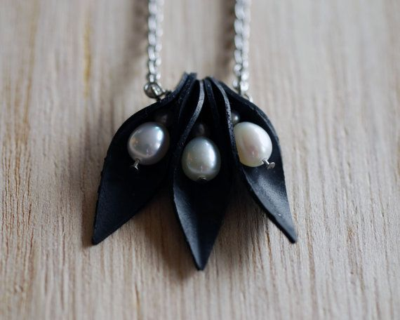 Black and white triple pod necklace handmade from recycled bicycle innertube and freshwater pearls by Lively leaf designs.