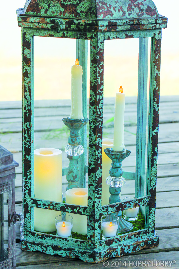 When decorating with large lanterns try mixing things up with an artful grouping of candles, candlesticks and votives— the trick is to use a variety of shapes and heights for interest.