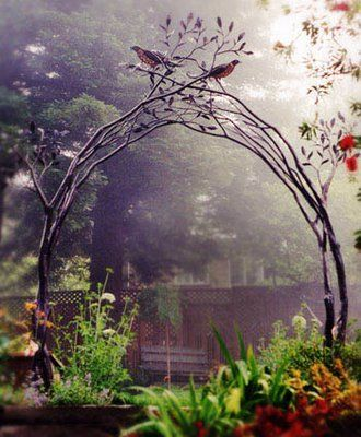 garden entrance - now THIS i LOVE! entwined branches forming an arch, leaves, birds