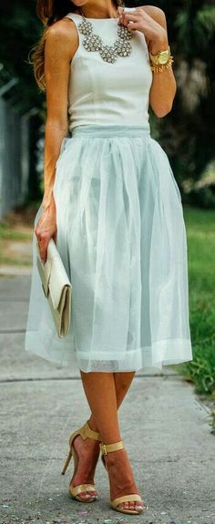 Like style of dress, color, necklace and bag