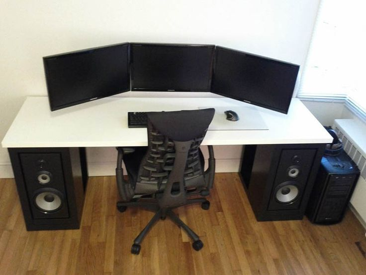 three monitor setup all landscape mounted to wall no cables showing and speakers on bottom