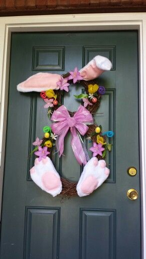 Bunny wreath using two grapevines. Made feet and ears with felt.
