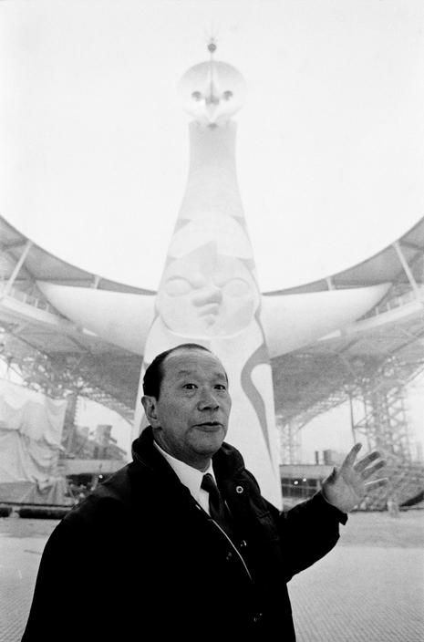 "Taro Okamoto in front of his sculpture ""Tower of the Sun"", the symbol of Expo'70 in Suita, Osaka, 1970 by Rene Burri"