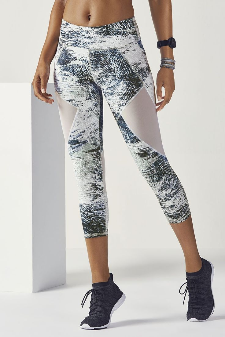 A wrap-around mesh-panel yoga capri amps up the airflow, so you can enjoy sweat-...