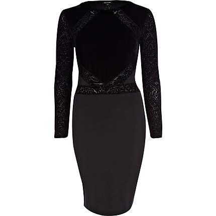From scene 1 outfit 1: BLACK VELVET FLOCKED BODYCON DRESS £40 River Island