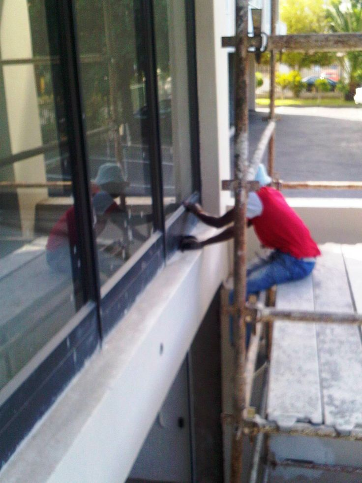 Our right hand man - Fred - resurfacing window frames at a building site in Claremont Cape Town.  www.betabaths.co.za