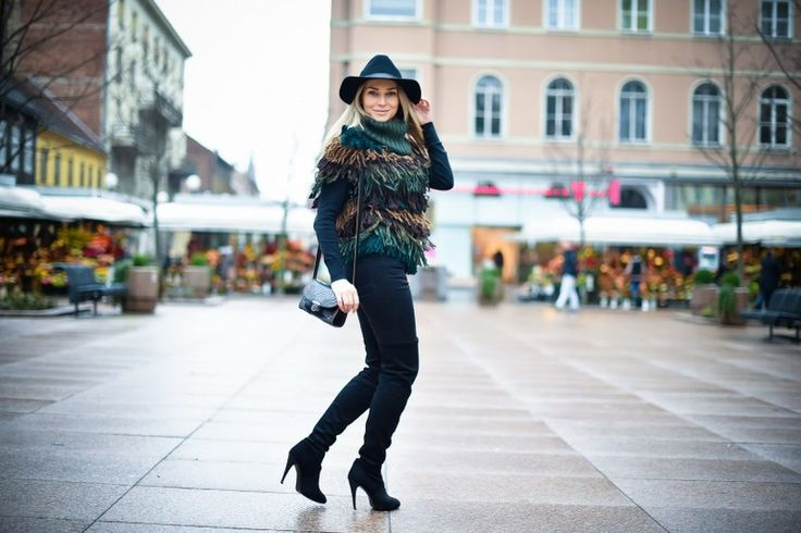 Sonja Kovač wearing over the knee boots and a rug sweater
