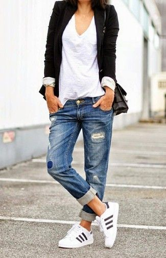 Women's White V-neck T-shirt, Black Blazer, Black Leather Crossbody Bag, Blue Ripped Boyfriend Jeans, and White Athletic Shoes