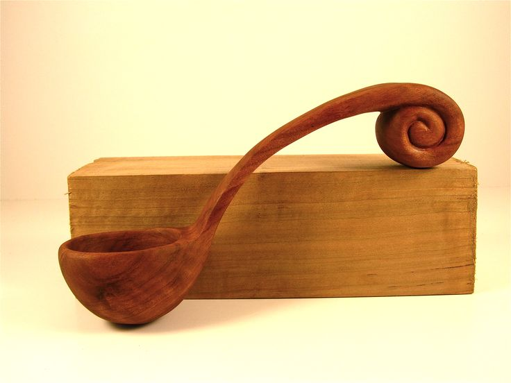 Cherry Wood Carved Ladle/Spoon.  Carved out of a piece of wood like the one it is resting on.  www.carmendelapaz.com