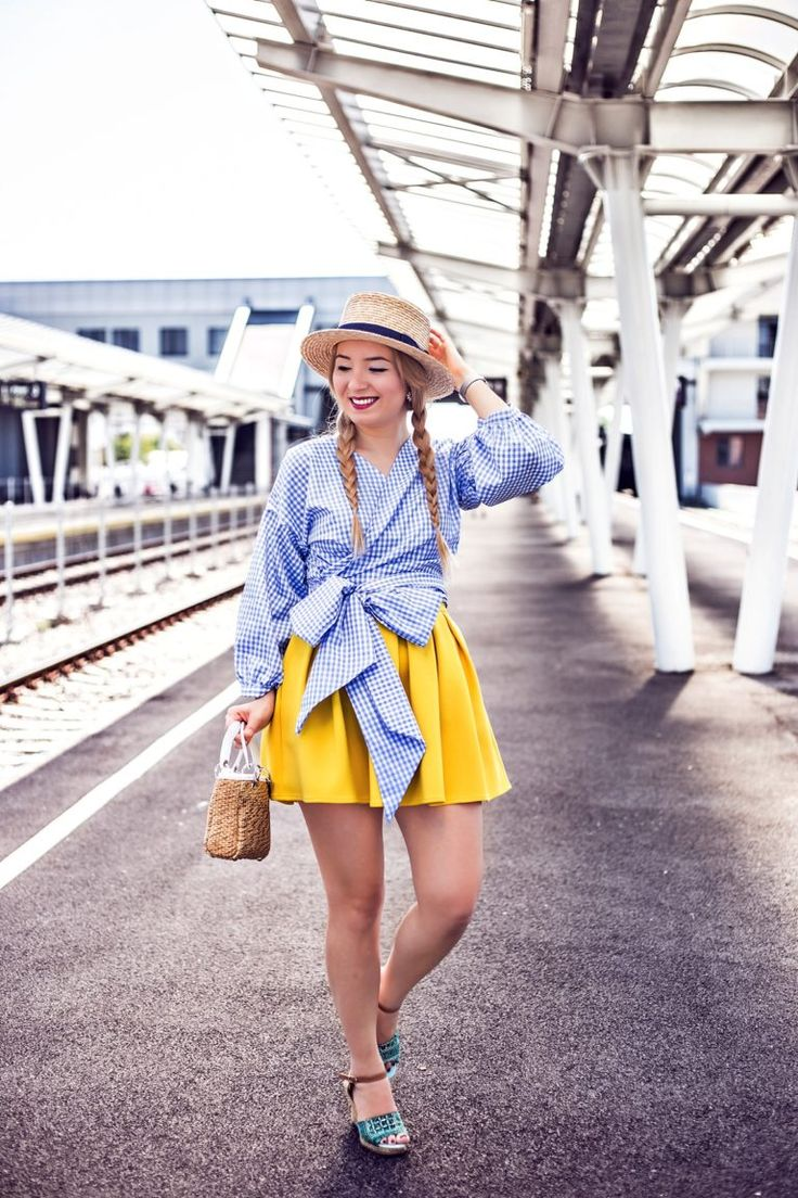Summer outfit with straw hat, yellow pleated skirt, striped blue blouse with big bow. By Andreea Ristea