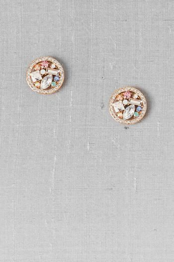 """These shimmering jeweled disks are filled with unique stones in a golden setting. Finished with post backs.<br><br> - 0.75"""" diameter<br> - Lead & nickel free<br> - Imported<br>"""