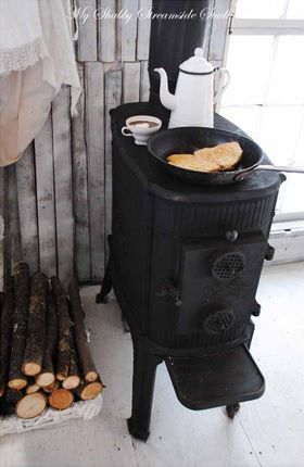 BEAUTIFUL! Larger flat top on woodburning stove for some morning yummy-bits... Mmm, feels like winter!
