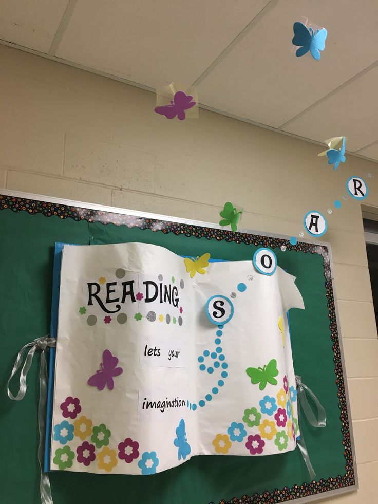 """Reading lets your imagination soar"" 3-D bulletin board. Butterflies are suspended from cellophane squares attached to fishing line."
