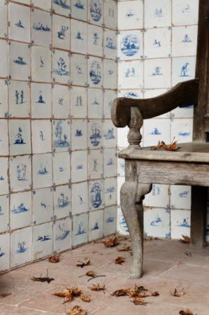 Delft tiles and part of a wooden bench in the Loggia at Standen, West Sussex.