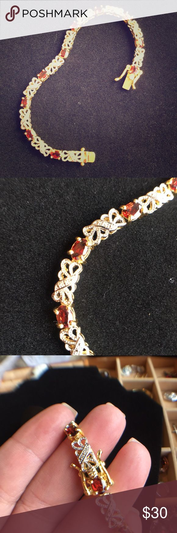 """Garnet and Silver Bracelet This is a 7 inch bracelet with 10 small garnets. It is marked """"Han 925 Thai."""" It has a nice secure safety latch. Jewelry Bracelets"""