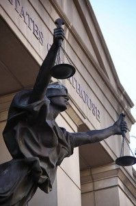 Lis Pendens - Whata it is! Justice Holding the Scales in Front of a Courthouse
