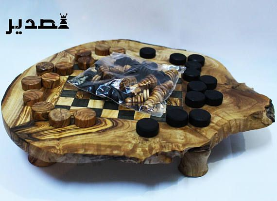 Prestigious games 2 in 1: chess games + Lady games Great for high range for Christmas gift, birthday or other occasions. Olive wood Board to play chess games or the Board comes with: -32 pieces chess (16 pieces for each player in wood color and black) -24 Lady pieces (12 pieces for each