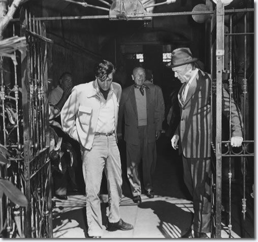 Hal Wallis, Elvis Presley, Michael Curtiz and Dean Jagger on location. March 3,1958.  The scene being shot is where 'Danny' meets 'Mr. Fisher' at 'Maxie's' Courtyard, 'It was an accident pa, I'm sorry honest, I tried to stop em, I did it for you'. 726 St. Peters Street, New Orleans (scene 154).  -