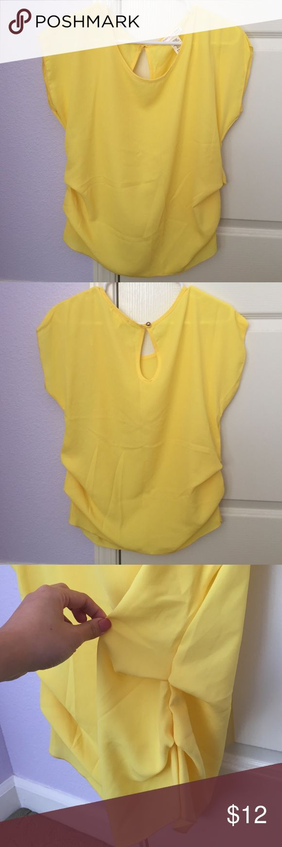 Agaci Yellow Short Sleeve Keyhole Top NWOT. Vibrant yellow short sleeve top from Agaci with ruched detail on the sides and keyhole closure in the back. Size S. Lightweight sheer material. Sorry, no trades or Paypal transactions. a'gaci Tops