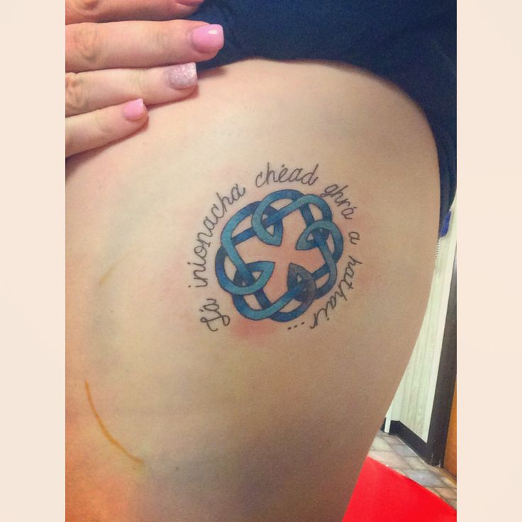 """My second tattoo! Celtic knot that represents a bond between a father & daughter. The blue is the December birthstone. """"Tá iníonacha chèad ghrá a hathair"""" ; """"A daughters first love is her father"""""""