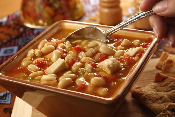 Saucy White Chili | MrFood.com, same basic recipe as Saucy Blond Chili, using ground turkey or pork.  My specialty. I double up on the cumin, chili powder and green chilies, no tomatoes.  This way looks good too though.