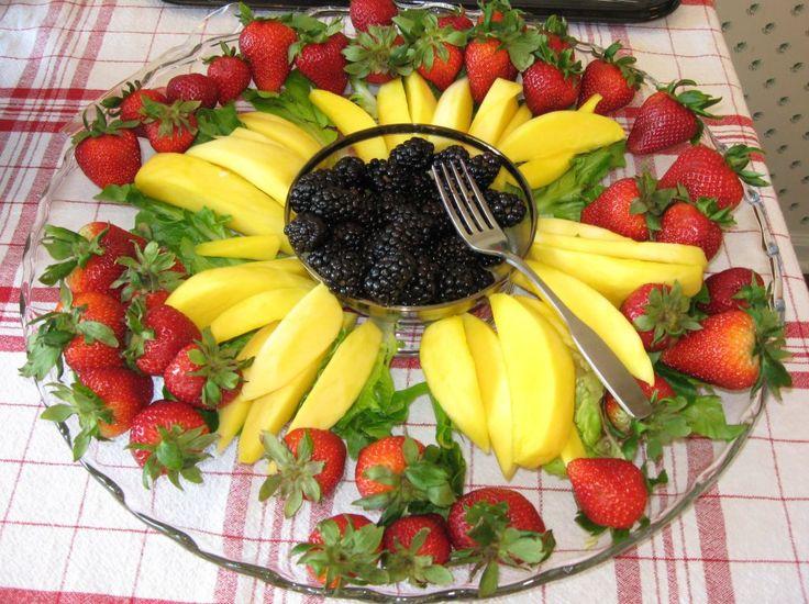 Sunflower fruit tray: mango petals with blackberry center; strawberries for garnish.  (Thanks, Mom!)