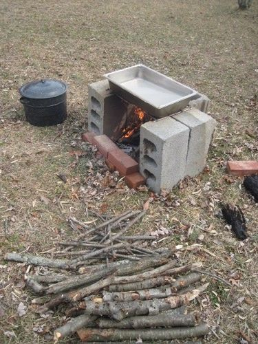 Nice fire pit set up for boiling maple sap into syrup