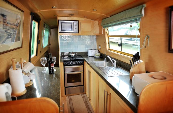 Compact, but well appointed river boat kitchen. English river boat - granite transformations- *