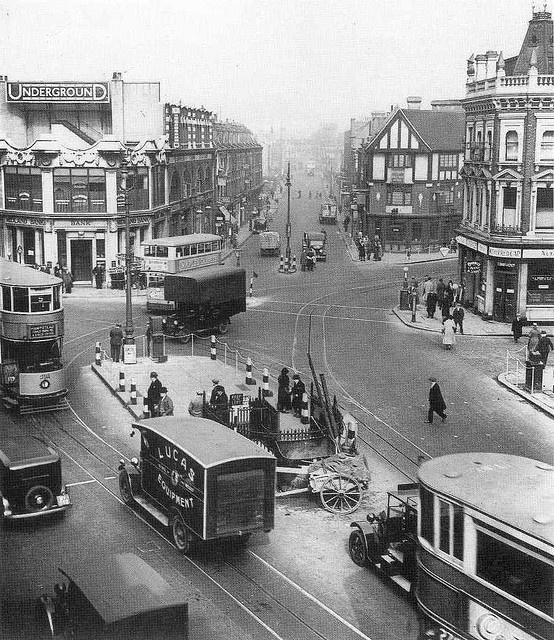 Camden Town underground, c 1920. World's End pub on the right, Kentish Town Road straight on, traffic on Camden High Street, toilets still in situ.