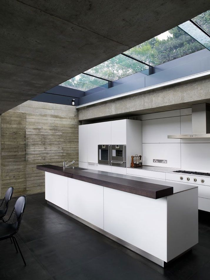 Love the off form concrete and the retractable skylight over the kitchen island. Cemetaries scare me, but this house which is situated on one, makes it look beautiful. Elliott House – North London, by Eldridge-Smerin Architects.: