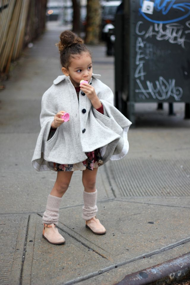 Street style by a mini fashion blogger. This cape is perfect for any occasion.