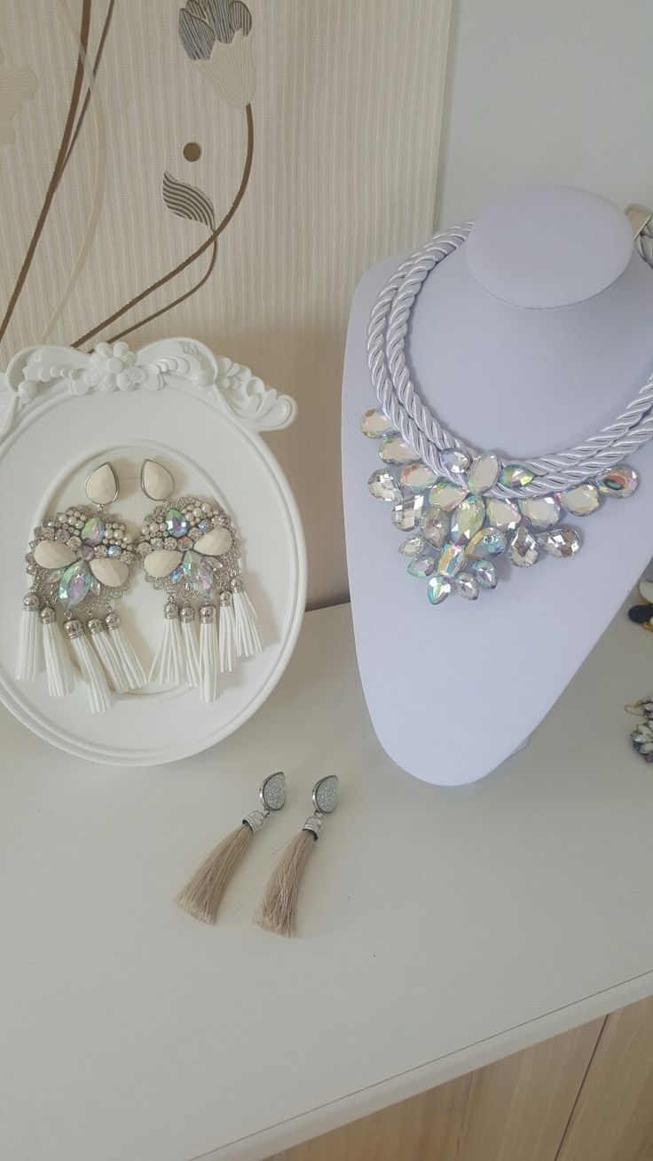 Neckles and earnings in white style.