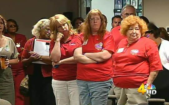 Dozens of teachers wore red shirts and packed into the meeting, where state education leaders talked about changes to the minimum pay schedule, which dictates the minimum amount a school district must pay a teacher.  For now, having more experience and holding an advanced degree earns teachers more money, but the state is changing that policy in favor of a system they say allows school districts more flexibility to reward high-performing teachers.