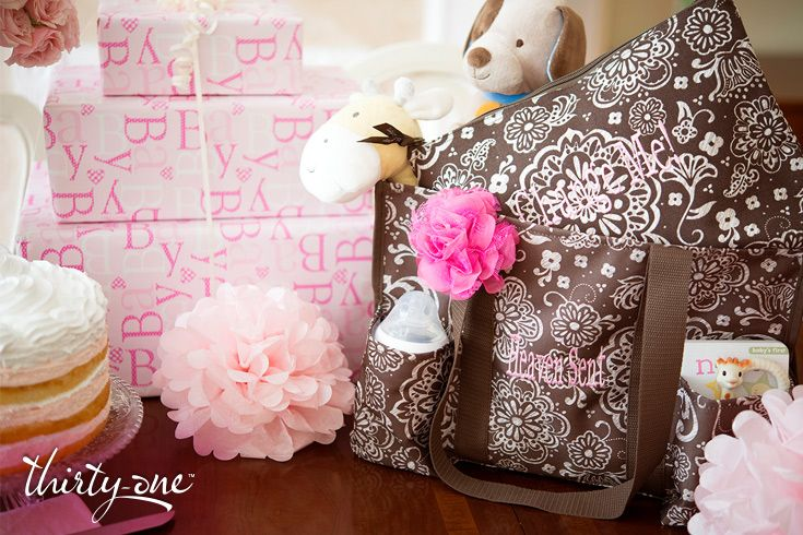 Help the Mom-To-Be get ready for motherhood by giving her this adorable and totally practical Zipper Pouch and Organizing Utility Tote with Rosette Clip.