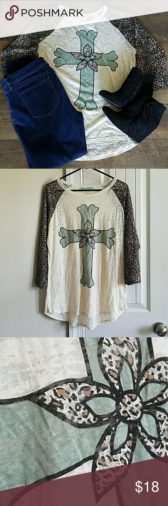 Animal Print Cross Top 3/4 length sleeve Soft and comfortable cross top with mesh animal print sleeve. Top is distressed and may need a cami underneath. Smoke free/puppy friendly home. Southern Grace Tops Blouses