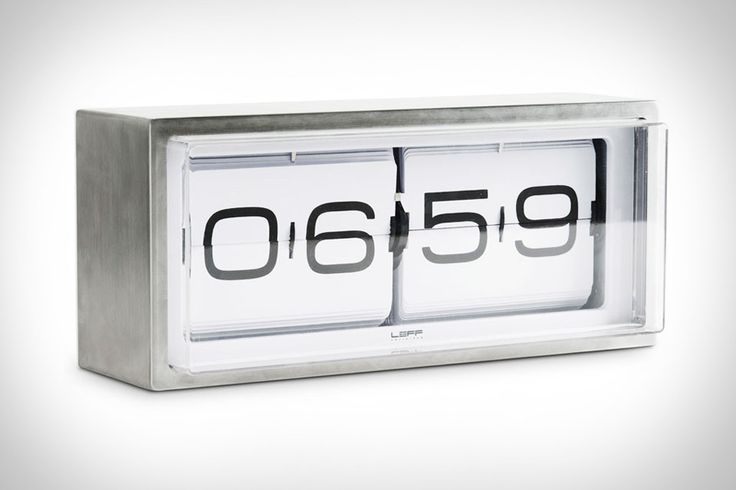 Brick Flip Clock: A vintage flip clock, reinvented and redesigned, with a unique combination of materials and graphics. Inside the stainless steel case a precision machine gives you a different composition of numbers every minute, also known as the time. This clock can be put on a desk or hung to the wall. Available in a 24 hours or an am/pm version.