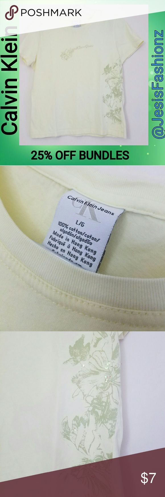 Calvin Klein Light Yellow Tropical Print Tee MEDIUM~Light almost pale yellow tee with tropical leaf print along the left side (when worn) and the name across the front. There is a tiny spot on the back side. It may come out in the wash, I'm not sure, I just saw it now during photos. I tried to show it, but it's not very visible  **25% OFF BUNDLES OF 3 OR MORE ITEMS** **REASONABLE OFFERS ACCEPTED** *ALL JEWELRY IS NWT/NWOT/UNUSED VINTAGE* ALL CLOTHING IS NWT/GENTLY WORN & CHECKED FOR ANY…