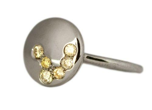 oro bianco al rutenio e diamanti champagne