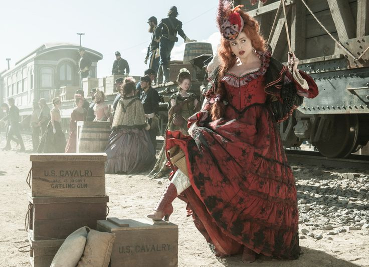 "Helena Bonham Carter's brothel madam, Red Harrington-The Lone Ranger-Helena Bonham Carter-dress-Image-credit-Disney Enterprises Inc-""Penny Rose's costume design is muted and more or less period accurate"""