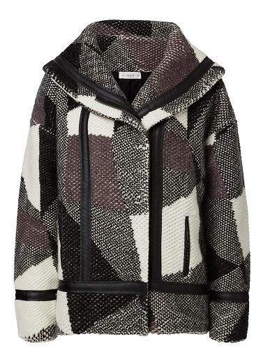 Acrylic/Wool/Pu/Polyester Hood Jacquard Jacket. Comfortable oversized swing fitting silhouette feautures a cape lapel,dropped shoulder, vertical jet pockets complete with leather look trims in an all over Jaquard knitted pattern. Available in Multi as seen below.