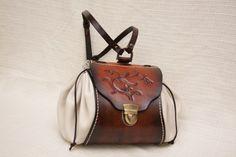 Genti piele, cadouri, decoratiuni, bratari, coliere, genti lucrate manual, carving, leather bags, gifts, leather belts, bracelets, hunter bag handmade
