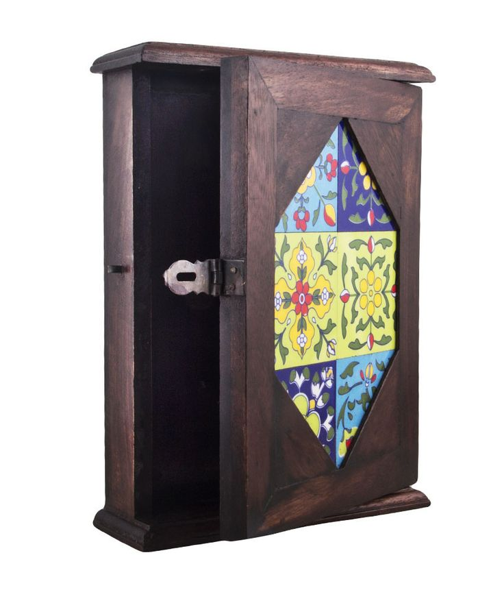 This wooden keyring holder with a wooden door is beautifully handcrafted. The door has a tiled diamond shaped design which gives it a classy touch. It has nine pegs to take care of your entire household keys. A must for every household.