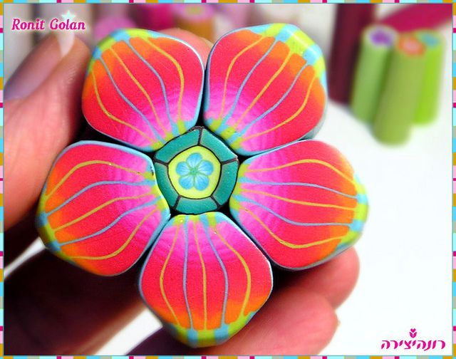 Polymer clay cane by Ronit-super bright flower cane-she is such a truly gifted artist. I always love her color palettes.