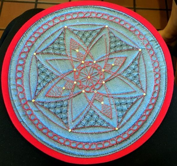 Beautiful medallion created by Inger Blood using the circle Ultimate Stencil.